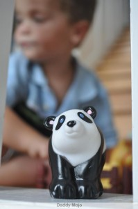 A Toddler plays with a Panda watermark